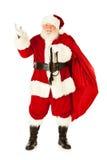 Santa: Święty Mikołaj przewożenia worek teraźniejszość Obrazy Stock