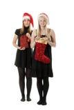 santa δύο καπέλων κοριτσιών Στοκ Φωτογραφίες