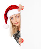 santa καπέλων Claus που φορά τη γυν&alp Στοκ εικόνα με δικαίωμα ελεύθερης χρήσης