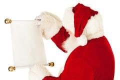 Santa: Κράτημα ενός κυλίνδρου καταλόγων Χριστουγέννων Στοκ Εικόνες