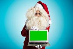 Santa με τις συσκευές στα χέρια Στοκ φωτογραφίες με δικαίωμα ελεύθερης χρήσης