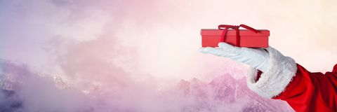 Santa με το δώρο εκμετάλλευσης χειμερινών τοπίων Στοκ Φωτογραφίες