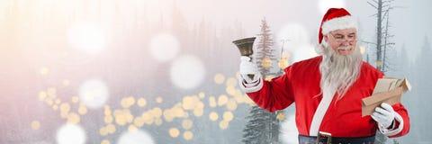 Santa με το κουδούνι εκμετάλλευσης χειμερινών τοπίων Στοκ Εικόνες