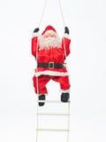 Santa παιχνιδιών που αναρριχείται σε μια σκάλα Στοκ Εικόνα