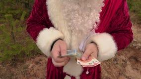 santa χρημάτων υπολογισμού Claus απόθεμα βίντεο