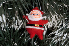Santa. Red christmas santa  on spruce background Stock Photo