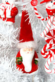 Santa. White Christmas tree decorated. Artifical. Red toys Stock Photos