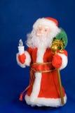 Santa. Kids christmas toy santa on blue Royalty Free Stock Photo