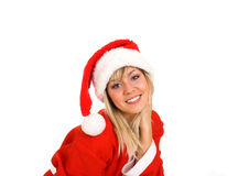Santa. Young blond girl in Santa Claus dress. Smiling Royalty Free Stock Photos