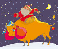 Santa. Claus sit on the bull Stock Images
