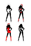 Santa. Four sexy women black figure wearing sexy red and white Christmas dreses and santa hat Stock Image