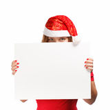 Santa advertisement. Woman in new year or christmas hat hiding behind the advertisement isolated on white background Royalty Free Stock Photo