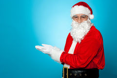 Santa against blue background Stock Photo