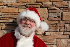 Santa Against A Stone Wall Royalty Free Stock Photos