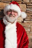 Santa Against a Stone Wall Royalty Free Stock Image
