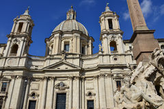 Santa Agnese in Agone in Piazza Navona Square. Beautiful baroque facade of Santa Agnese in Agone in Piazza Navona and Fountain of Four River designed by famous Stock Photo