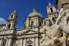 Santa Agnese Church with Fountain of Four River. Santa Agnese church and River Gange statue in the beautiful Bernini's fountain in Piazza Navona Royalty Free Stock Images