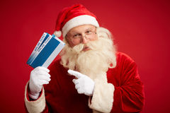 Santa with airline tickets Stock Photo