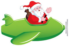 Santa in Airplane. Santa Claus is flying airplane to distribute gifts on time Stock Photos