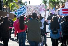 2018 Women`s March in Santa Ana, California. Santa Ana, California - January 20, 2018: Women holding an anti-Trump signs at the 2018 Women`s March in Santa Ana Royalty Free Stock Photos