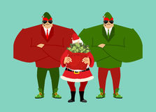 Free Santa And Bag Of Money. Elf Claus Bodyguards. Christmas Gift Cash. Red Sack With Dollars Royalty Free Stock Image - 82574166