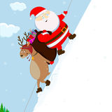 Santa And Reindeer Climb The Mountain Royalty Free Stock Image
