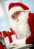 Santa answering e-mail Royalty Free Stock Photos