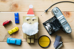 Santa and antique cameras placed on wood. Royalty Free Stock Image