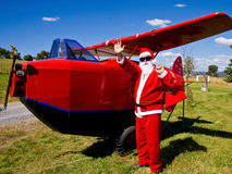 Santa arrives for Christmas party. Santa Clause waves to children on arrival by toy plane Stock Images