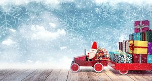 Santa arriving from sky with car full of Christmas presents. 3D Rendering Royalty Free Stock Images