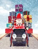 Santa arriving from sky with car full of Christmas presents. 3D Rendering Stock Photos
