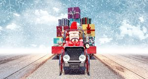 Santa arriving from sky with car full of Christmas presents. 3D Rendering Stock Photo