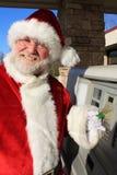 Santa At the ATM 2. Santa Cluas using the ATM machine Royalty Free Stock Photography