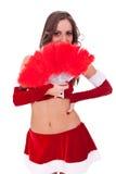 Santa atractivo con el ventilador rojo de la pluma Foto de archivo