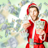 Santa with Australian money at christmas sales Stock Images