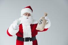 Santa avec des billets de banque du dollar Image stock