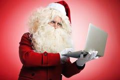 Santa avec des instruments dans des mains Photo libre de droits