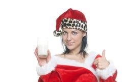 Santa avec du lait Photographie stock libre de droits