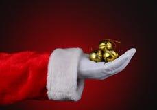 Santa avec la poignée de Sleigh Bells Images stock