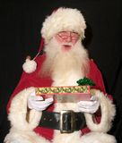 Santa avec le cadeau Photos libres de droits