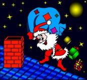 Santa avec le cadeau sur le toit. Photo libre de droits