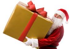 Santa avec le grand cadeau Photo stock