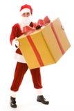 Santa avec le grand cadeau Photos libres de droits