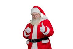 Santa avec le tuyau renonçant au pouce Photographie stock