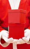 Santa avec les cadeaux rouges de Noël Image stock