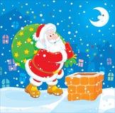 Santa avec sa valise des cadeaux Photos stock