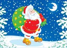 Santa avec sa valise des cadeaux Photo libre de droits