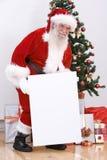 Santa avec un panneau blanc Photos libres de droits