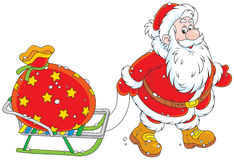 Santa avec un sac de cadeau Photographie stock libre de droits
