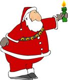 Santa avec une bougie Image stock